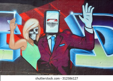 SHERBROOKE QUEBEC CANADA AUGUST 29 2015: Street art robot and zombie Sherbrooke is the perfect place to walk in the back alleys and abandoned areas, looking for street art