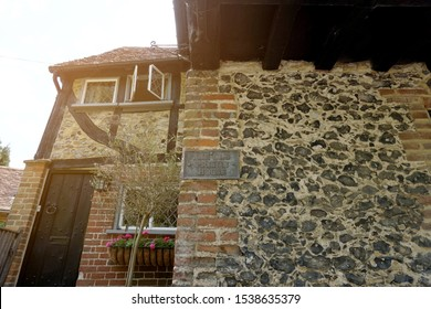 SHERE, GUILDFORD, UK-26 MAY 2019: Part of stone and brick building of a charming cottage, The Old Prison House at Shere, Lower Street, Surrey, Guildford, southern England, United Kingdom