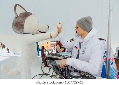 Sheregesh, Kemerovo Region - April 6, 2018. U-Laika symbol of Universiade 2019 with DJ. Promo zone of the Universiade 2019 in Krasnoyarsk.