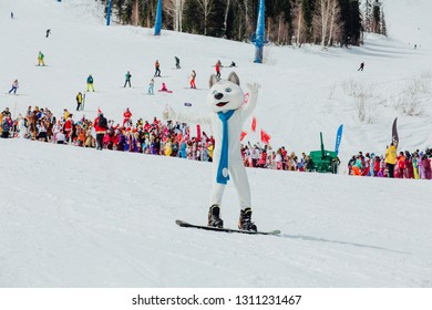 Sheregesh, Kemerovo region, Russia - April 7, 2018: Grelka Fest is a sports and entertainment activity for ski and snowboard riders in carnival costume. U-Laika symbol fo Universiade 2019 on the slope