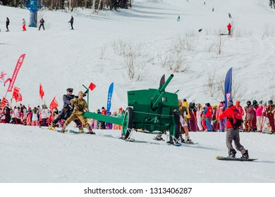 Sheregesh, Kemerovo region, Russia - April 7, 2018: Grelka Fest is a sports and entertainment activity for ski and snowboard riders in carnival costume. Young people in carnival of soldiers costumes.