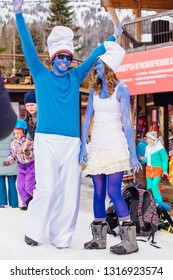 Sheregesh, Kemerovo region, Russia - April 7, 2018: Grelka Fest is a sports and entertainment activity for ski and snowboard riders in carnival costume. Young people in carnival costumes of Smurfs.