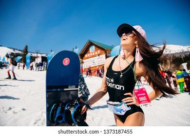 Sheregesh, Kemerovo region, Russia - April 13, 2019: Grelka Fest ski and snowboard riders in bikini.