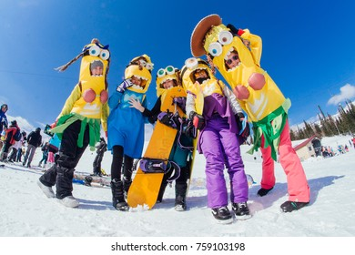 Sheregesh, Kemerovo region, Russia - April 22, 2017: Grelka Fest is a sports and entertainment activity for ski and snowboard riders in carnival costume. Group of people in costumes of minions