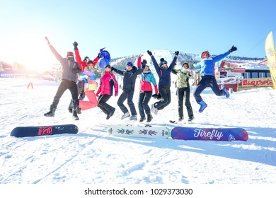 Sheregesh, Kemerovo region, Russia - January, 2018: People jumping with skis and snowboards on the mountain. Group of eople skiing and snowboarding in the winter.