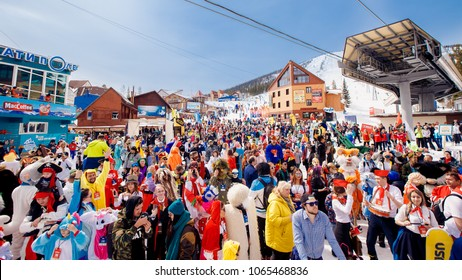 Sheregesh, Kemerovo, Russia - April 7, 2018: Grelka Fest: Group of people ski and snowboard riders in carnival costumes.
