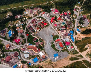 Sheregesh, Kemerovo, Russia - August 16, 2018: Aerial view drone roof of hotels in summer