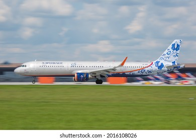 Sheremetyevo International Airport, Moscow, Russia - 06.14.2021. Passenger aircraft Airbus A321 of Aeroflot - Russian Airlines in special «Gzhel» livery lands on the airport runway. Long exposure.