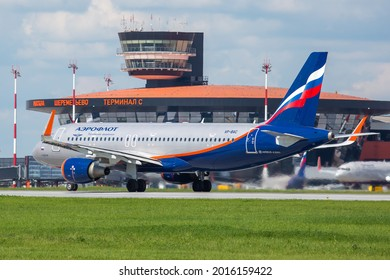 Sheremetyevo International Airport, Moscow, Russia - 06.14.2021. Modern passenger airplane Airbus A320 of Aeroflot - Russian Airlines takes off from the airport runway. ATC Tower in the background.