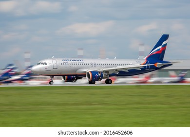 Sheremetyevo International Airport, Moscow, Russia - 06.14.2021. Passenger aircraft Airbus A320 of Aeroflot - Russian Airlines lands on the airport runway. Reverse activated. Long exposure.