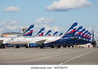 SHEREMETYEVO INTERNATIONAL AIRPORT, MOSCOW, RUSSIA - AUGUST 8, 2017: Regional aircrafts Sukhoi Superjet 100 of a Aeroflot - Russian Airlines parked on the airfield.