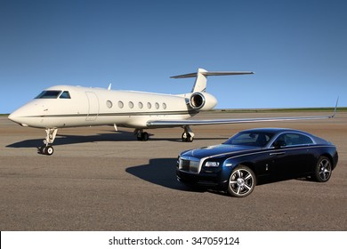 SHEREMETYEVO, MOSCOW REGION, RUSSIA - APRIL 24, 2015: Private Gulfstream G550 executive airplane with Rolls Royce Wraith luxury car shown together at Sheremetyevo international airport.