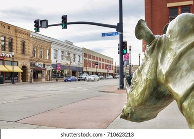 Sheridan, USA - October 30, 2016: Bronze rhino on a pavement. This sculpture called The Boss was created by Dollores B. Shelledy and donated by the Sheridan Public Arts Committee in 2006.