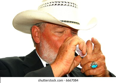 Sheriff - about to light his pipe (Kenny Rogers lookalike)