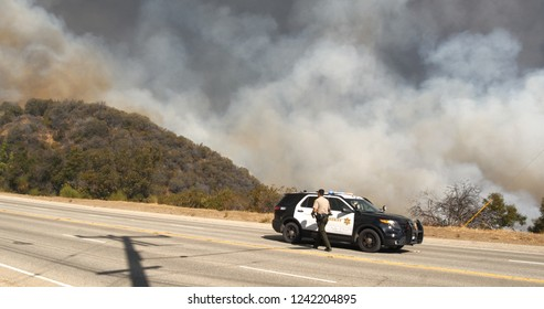 Sheriff Department attend to Woolsey Fire Cloud Malibu off Kanan Road Disaster