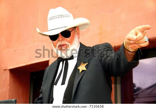 Sheriff pointing while holding a speech