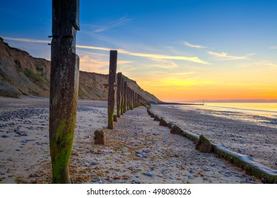 Sheringham beach and cliffs at sunset,Norfolk,England in summer