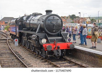 SHERINGHAM, NORFOLK, UK - JUNE 23, 2012: LMS Stanier Class 5 4-6-0 No. 45337 runs around its train at Sheringham on the North Norfolk Railway during the 'Titfield Thunderbolt' event.