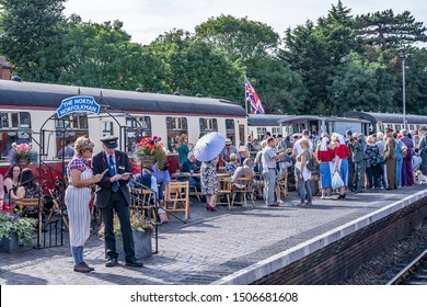 Sheringham, Norfolk, UK – September 14 2019. Revellers dressed in 1940s style clothing pack out Sheringham train station during the annual forties weekend