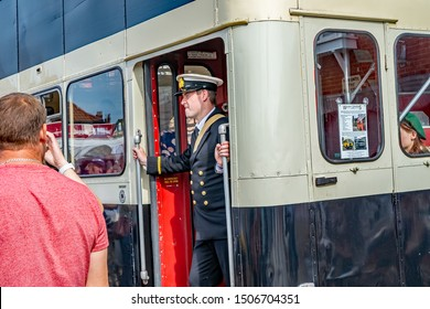 Sheringham, Norfolk, UK – September 14 2019. A young male dressed in vintage clothing as a bus conductor on board a classic 1940s bus at the annual forties weekend in Sheringham Norfolk