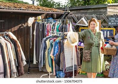 Sheringham, Norfolk, UK – September 14 2019. Female retailer selling 1940s style vintage clothing during the annual forties weekend at Sheringham, Norfolk