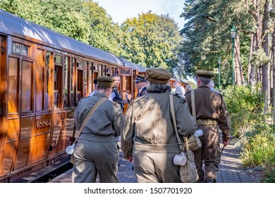 Sheringham, Norfolk, UK – September 14 2019.Group of people dressed as 1940s soldiers walking up the railway platform in Holt to board a rail carriage during the annual forties weekend held in Holt