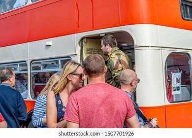 Sheringham, Norfolk, UK – September 14 2019. People waiting to board the vintage 1940s bus during the annual forties weekend in Sheringham Norfolk