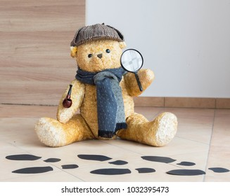 Sherlock teddy bear detective investigates crime - footprints on the floor