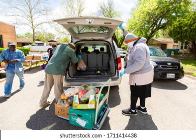 Sherman, TX / United States - April 1 2020: Members of the St John's Christian Methodist Episcopal Church in Sherman, TX, host a drive- up food pantry on April 1, 2020.
