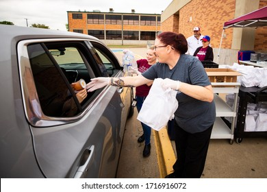 Sherman, TX / United States - April 1 2020: The Sherman ISD Food Service Staff hands out lunches on April 2, 2020 at Piner Middle School.