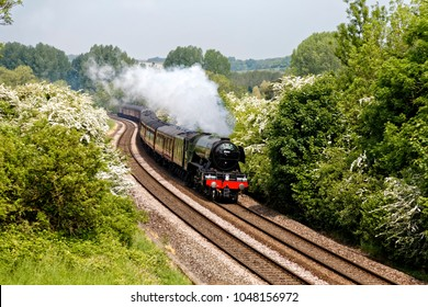 Sherrington, Wiltshire, UK - May 28, 2016.A3 Class 60103 Flying Scotsman steams through the Wiltshire countryside on a beautiful sunny morning with the Cathedrals Express as it heads towards Salisbury