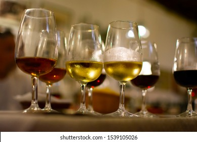 Sherry wine tasting in wine cellars, selection of different fortified wines from dry to very sweet in glasses, Jerez de la Frontera, Andalusia, Spain