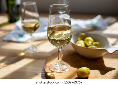 Sherry wine tasting, dry fino  jerez fortified wine made from palamino white grapes and olives with garlic, El Puerto de Santa Maria, Andalusia, Spain