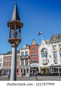 's-Hertogenbosch, Netherlands - August 2018: Small tower with statue of Saint Mary holding Jesus on the market square in the city center