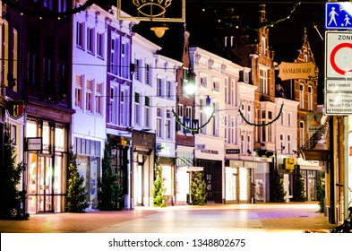 's-Hertogenbosch, Netherlands - december 15 2015: Kerkstraat in Den Bosch at night with a view on it's shopping windows and colorful facades.