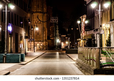 's-Hertogenbosch, Netherlands - december 15 2015: A night view on the Kerkstraat in Den Bosch. The Sint-Jan Cathedral on the end of the street.