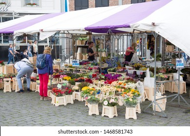 's-Hertogenbosch, The Netherlands - May 2019. View of the weekly market and chain store Hudson Bay located on the center market square in Den Bosch, The Netherlands.