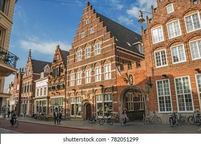 s-Hertogenbosch, southern Netherlands - July 01, 2017. Street with restaurants, shops, cyclist and people strolling in the s-Hertogenbosch downtown. Gracious historical city with vibrant cultural life