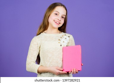 Shes a student of language and literature. Cute little child holding book in English literature. Adorable small girl reading literature book. Fiction and scientific literature, copy space.