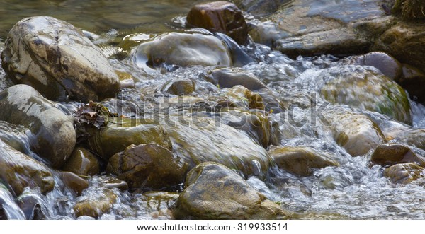 sheshorskie waterfalls in the mountains of the Carpathians Ukraine