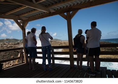 Shete Boka, Curacao - March 02, 2018: Tourist watchig Boka Pistol explosion at the Shete Boka natural park, Curacao