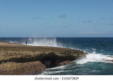 Shete Boka, Curacao - March 02, 2018: Couple taking photo as wave crushing  at Shete Boka national park, Curacao