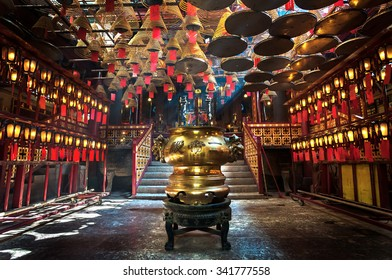 SHEUNG WAN, HONG KONG - JULY 12, 2013 - Inside the main hall of Man Mo Temple, Sheung Wan, Hong Kong. Man Mo Temple was built in 1847 and is a popular tourist destination.