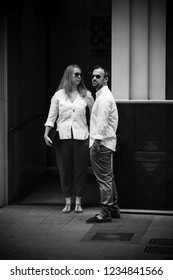 SHEUNG WAN, HONG KONG - MARCH 31, 2018 : Unidentified tourists standing on Hollywood Road in Sheung Wan, Hong Kong. Black and white.