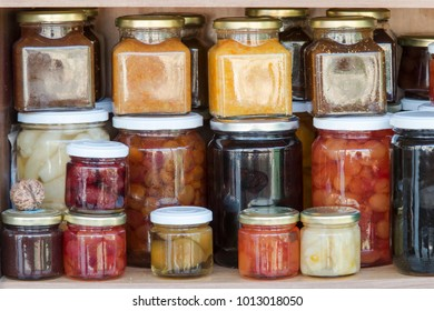 shevels with home made fruits in preserving jars