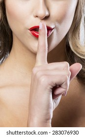 Shhhh blonde with finger infront of lips