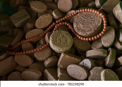 """Shia Islam prayer beads and clay from Karbala with the writing """"peace be upon you oh father of Abdullah"""""""