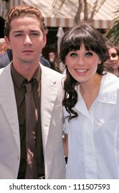 "Shia LaBeouf and Zooey Deschanel at the Los Angeles Premiere of ""Surf's Up"". Mann Village Theatre, Westwood, CA. 06-02-07"