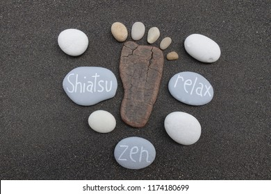 Shiatsu, Zen and Relax concept with stones over black volcanic sand