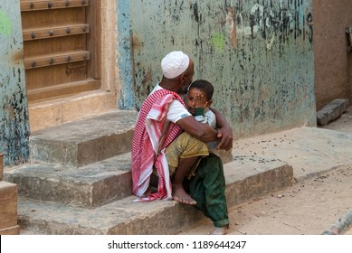Shibam, Yemen - May 8, 2007: A little boy cries in the arms of his father. Although infant mortality is high, children in Yemen are culturally and socially valued.